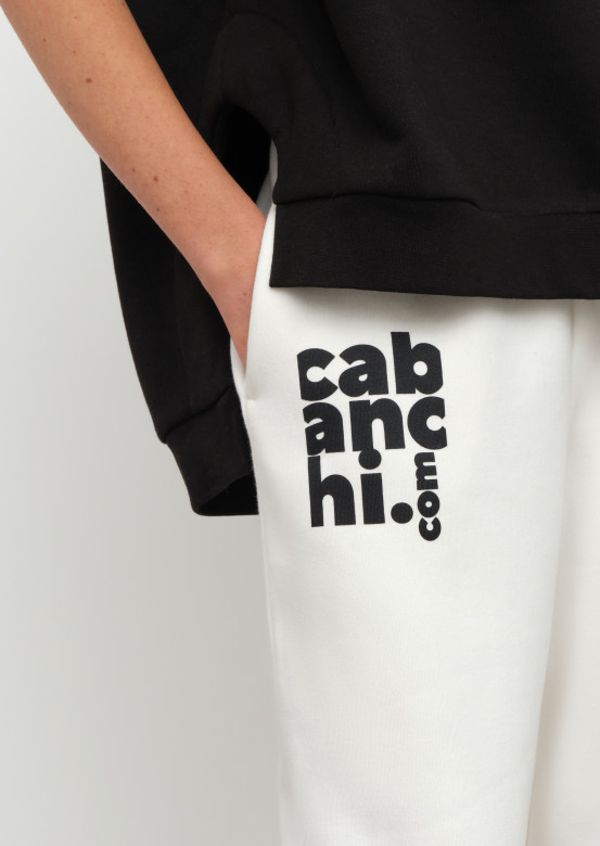 Milky colour footer trousers with Cabanchi.com print